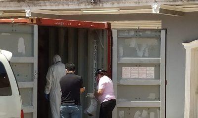 Contenedores donde fueron hallados los cuerpos. Foto Judiciales.